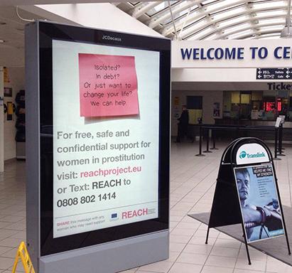 REACH advert in Belfast Central Station